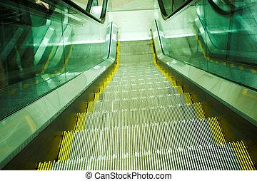 Move escalator in modern office - Green move escalator in...