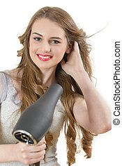 Woman using Hairdryer - Beautiful woman drying her hair with...