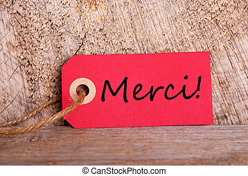 Red Tag with Merci - A Red Tag on Wood with the French Word...