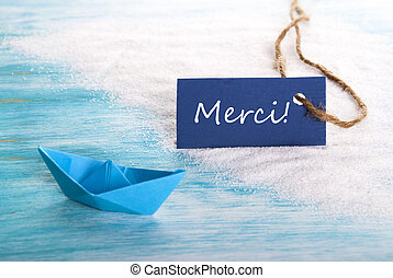 Blue Tag with Merci - A Blue Tag with the French Word Merci...