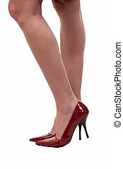High heel shoes - Womans bare legs standing on white wearing...