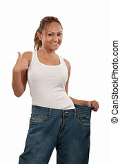 Successful diet - Attractive slim Asian woman smiling...