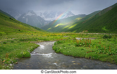 Rainbow in the mountains of the Caucasus - Rain in the...