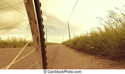 Biking - Low angle view shot of riding a bicycle on country...
