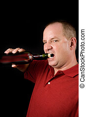 Wine Connoisseur - A wine connoisseur uncorking a bottle of...