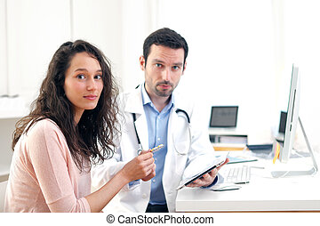 Doctor using tablet to inform patient - View of a Doctor...