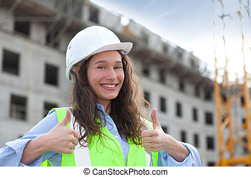 Woman worker on a construction site - View of a Woman worker...