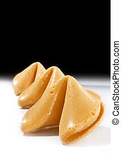 Black and white fortune cookies - Fortune cookies over black...