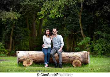 Portrait of a young happy couple in the nature