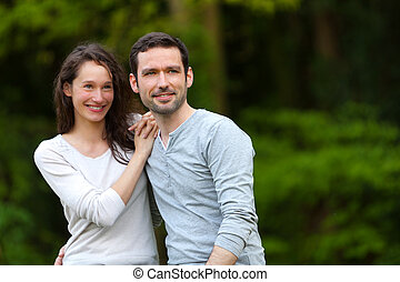 Portrait of a young happy couple in the nature - view of a...
