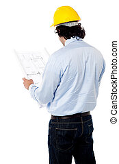 Civil engineer analyzing construction plan - Back view of...