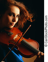 Playing the violin. Musical instrument with performer hands...