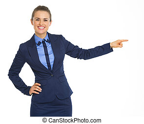 Smiling business woman pointing on copy space