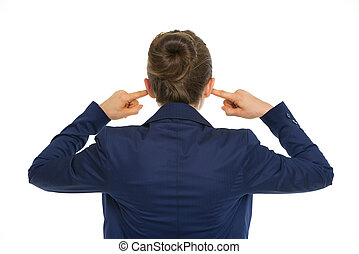 Business woman closing ears rear view