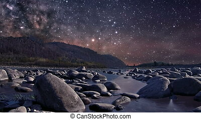 Starry night over the river - Time lapse of starry sky over...