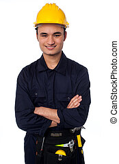Young handyman with a tool belt - Smiling young male...