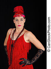 Young beautiful brunette in 1920 style attire red dress and...
