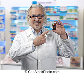 caucasian mature male pharmacist on a out of focus...