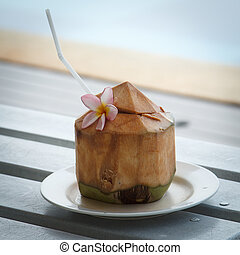 Coconut water is placed on the table and refreshment.