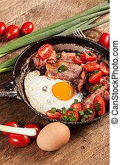 English breakfast. - Fried eggs with bacon and tomatoes.