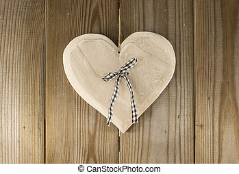 hanging valentines heart shape on wooden backkground