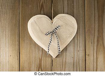 hanging valentines heart shape on wooden backkground