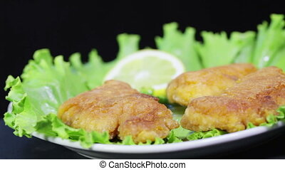 Roasted Fish roe on leaves of lettuce - On a rotating...