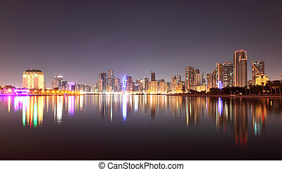 Skyline of Sharjah City at night. United Arab Emirates