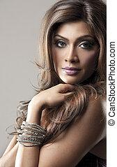 fashion woman - beautiful woman wearing purple dress on grey...
