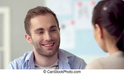 Positive Dialog - Close up of man talking to woman
