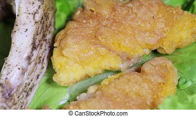 Roasted fish and Fish roe on leaves of lettuce - On a...