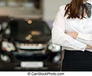 Representative female in car dealership salon.