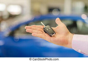 Closeup view of  modern car key on open male handbreadth