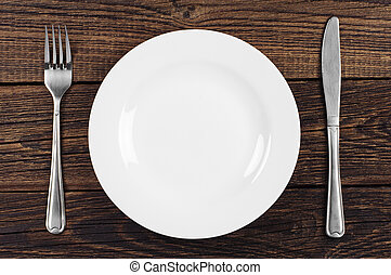 Empty plate, fork and knife - Empty plate, fork and table...