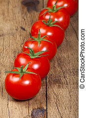 Fresh ripe Tomatoes in a Row