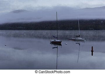 Boats on a lake with fog