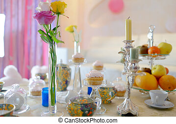 Holiday tea party and white table with beautiful tableware...