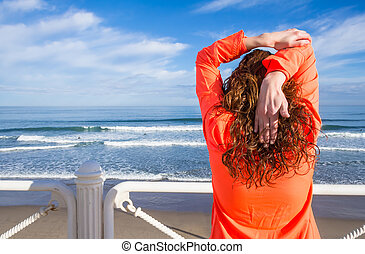 Young girl warming before running in a promenade - Athletic...