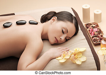 asian woman in spa with hot stones - health and beauty,...