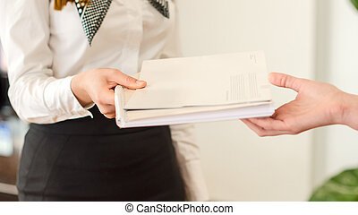 Female hands holding documents. Agreement concept.