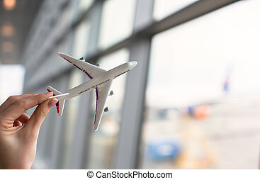 Close up hand holding an airplane model background the...