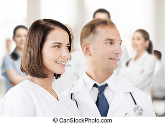 two doctors with stethoscopes - healthcare and medical...