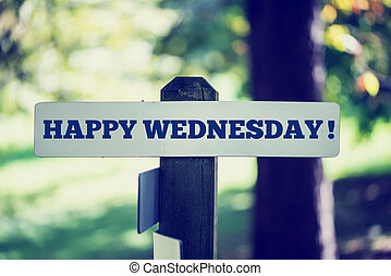 Happy wednesday signpost in beautiful woodland with a...