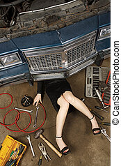 female fixing her car - A female wearing a black skirt and...