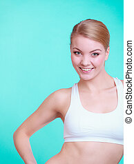 Portrait of young sporty woman fit fitness blond girl