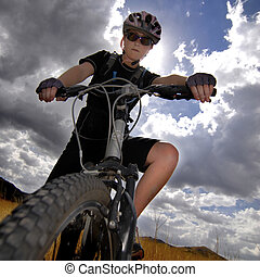 Young Woman Mountain Biking - Young Woman Riding Mountain...