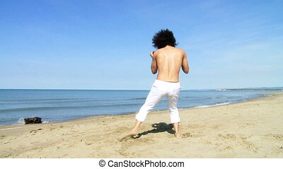 Professional dancer on the beach - Cool man dancing on the...