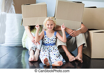 Family having fun in its new house - Young family having fun...