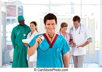 Doctor with colleagues in the background