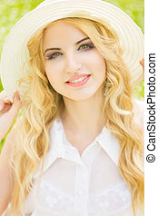 Portrait of a beautiful young blonde woman with wavy hair in...